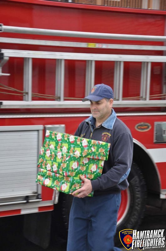 "The Hamtramck Firefighters ""adopted"" two families this holiday season. We provided presents, food and clothing to help these families have a happy holiday."